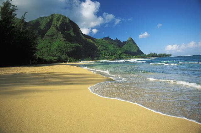 Hawaii, Kauai, Haena, Tunnels beach with shadow on sand and Bali Hai background, shoreline